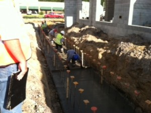 Smoothing poured concrete in trench